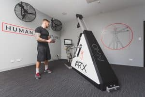 intense health marcelo in the perth training chamber looking at arx fit machine copy